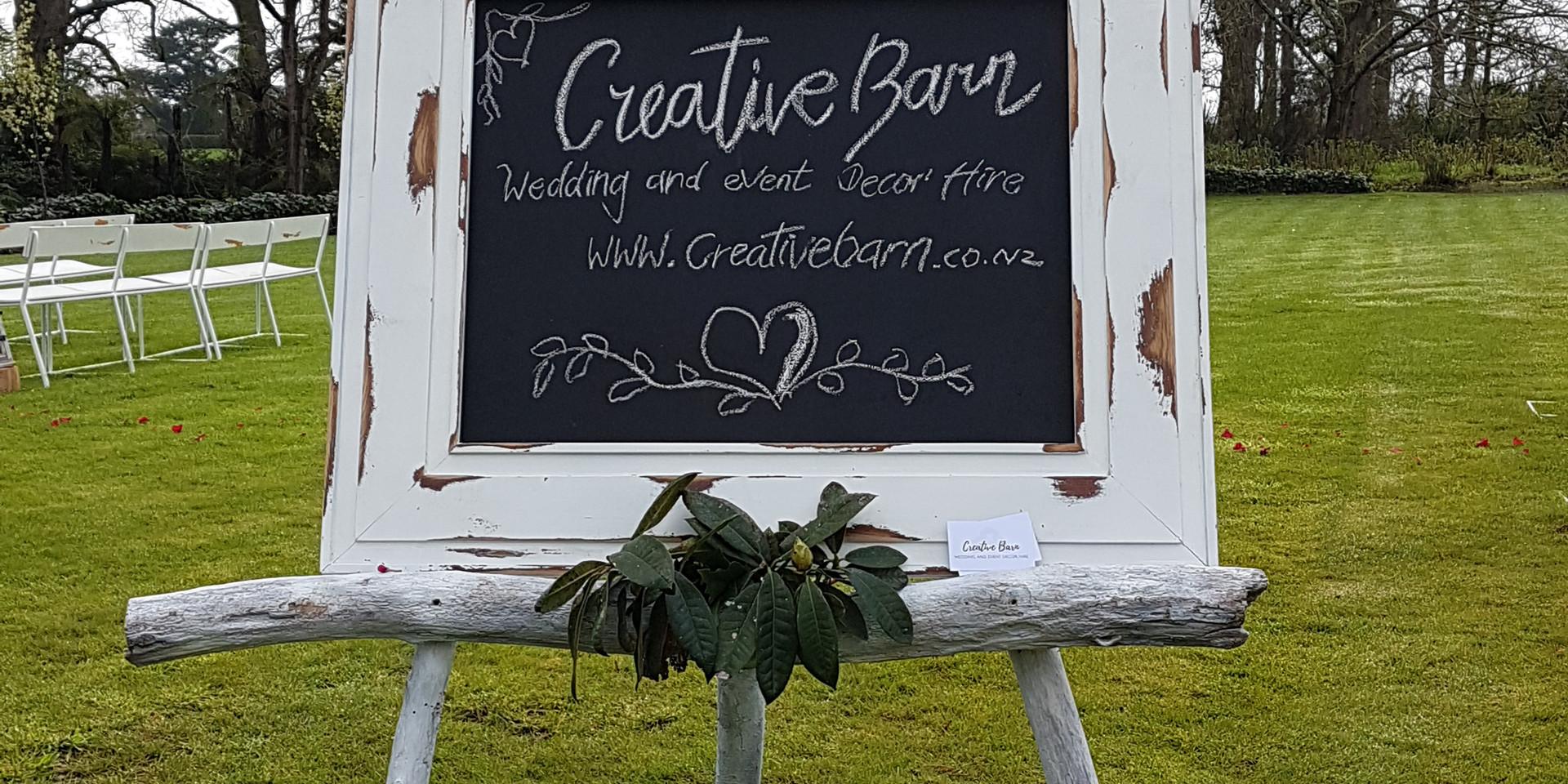 white blackboard and white easel