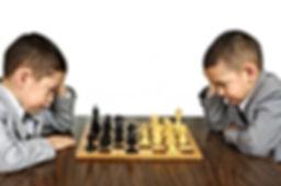 kids-playing-chess-13737451.jpg