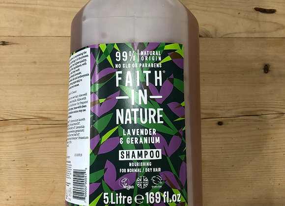 Faith in Nature lavender and geranium shampoo in 5 litre container on wooden background