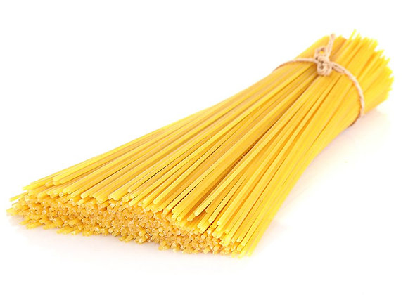 Dry spaghetti wrapped in twine on a white background