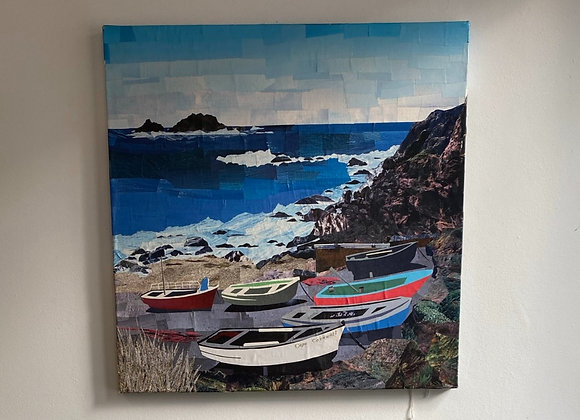 Cape Cornwall beach scene with blue ocean cliff and boats