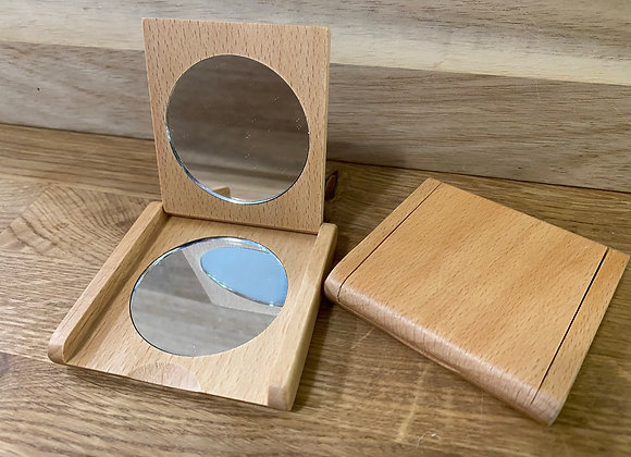 Wooden case with standard mirror on one side and magnified mirror on the other sider