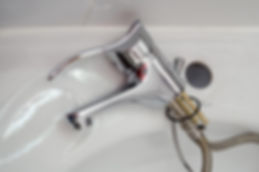mono block tap resting on wash basin and