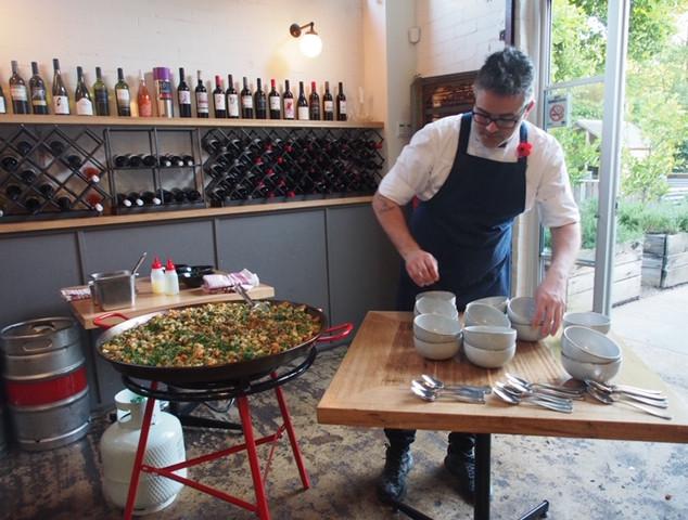 mauro with bowls - paella .jpg
