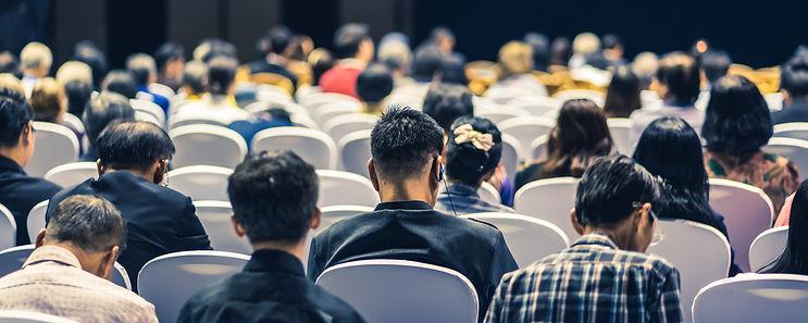 audience-listening-speakers-stage-conference-hall-seminar-meeting.jpg