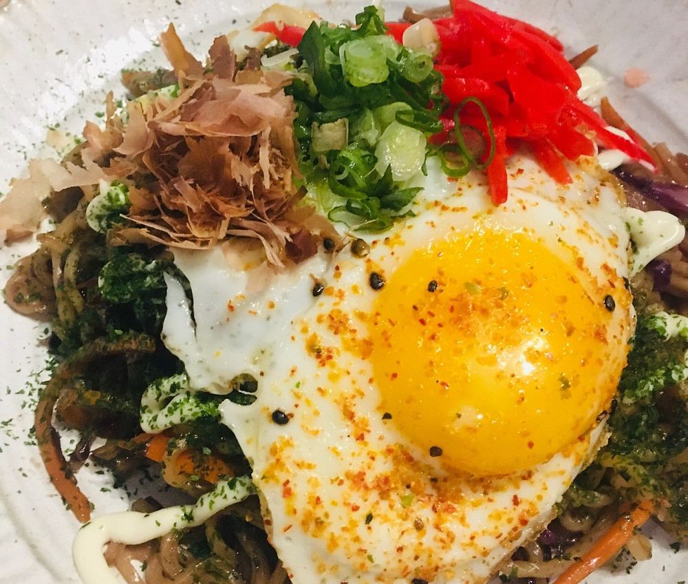 Udon noodle dish with fried egg