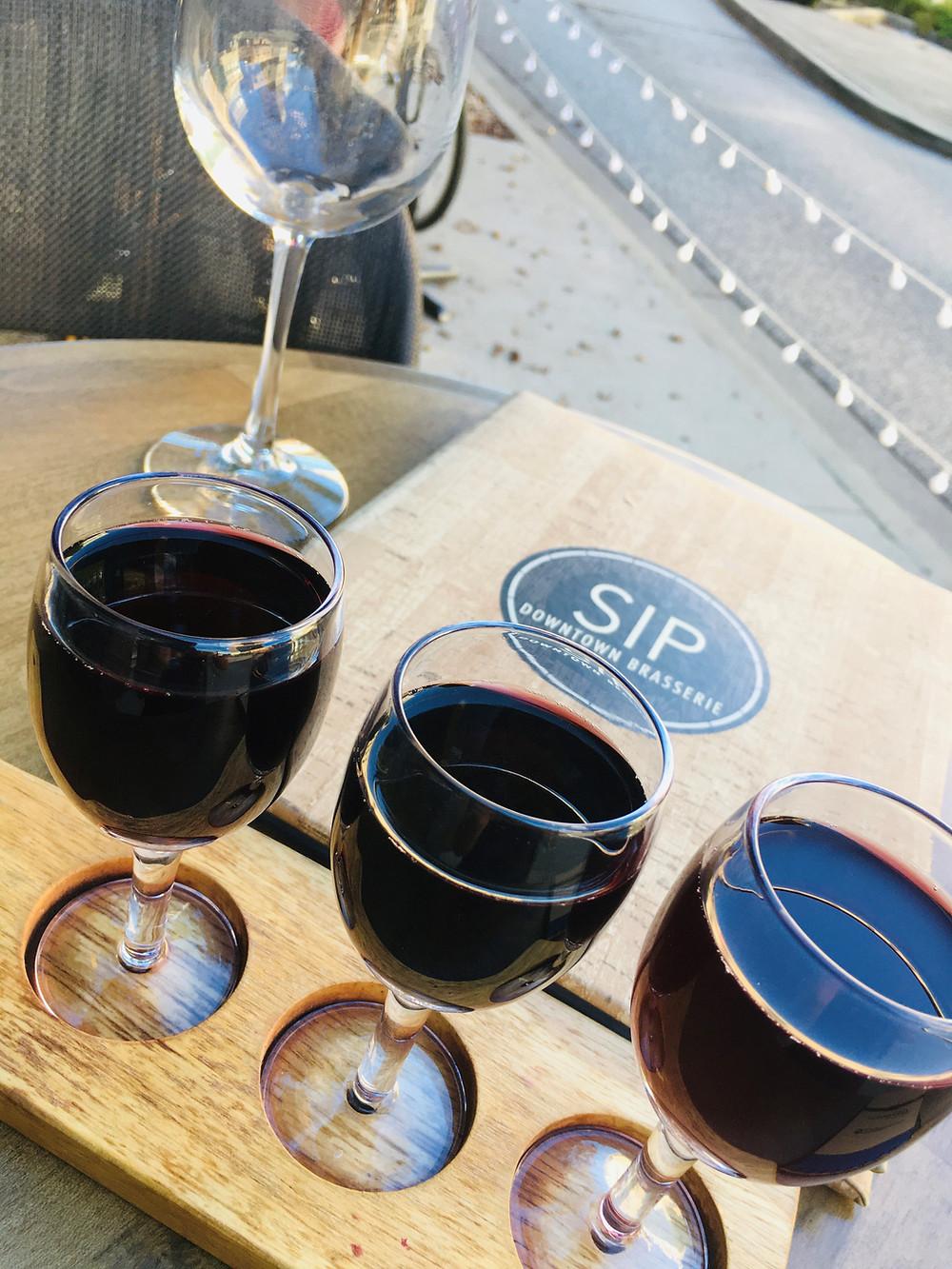 Red wine flight at Sip Wine & Whiskey Bar