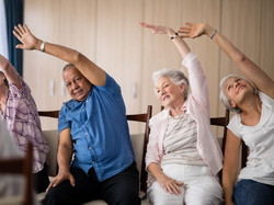 Senior-people-stretching-while-198881071