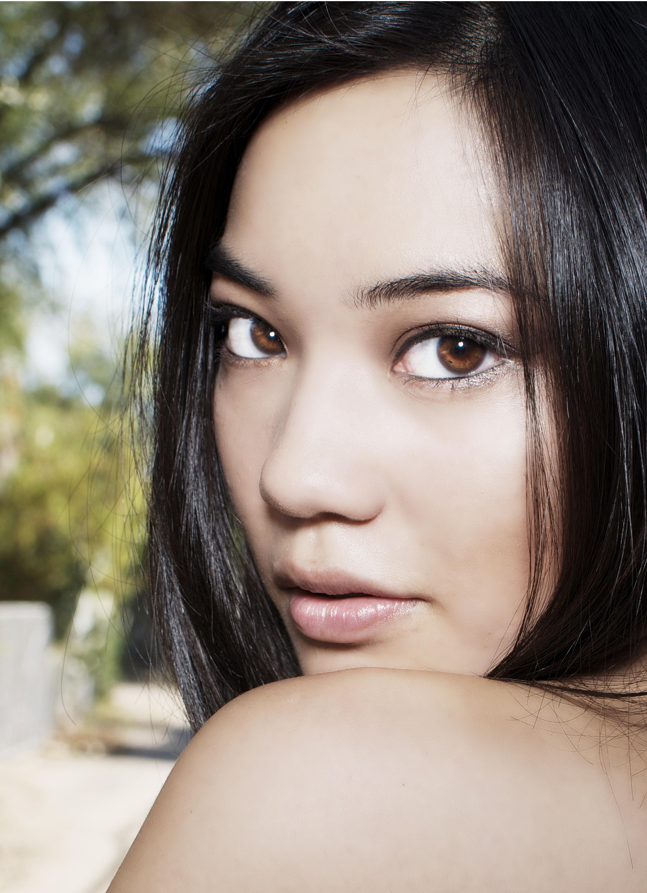 bigstock-Beautiful-young-Asian-woman-25764488