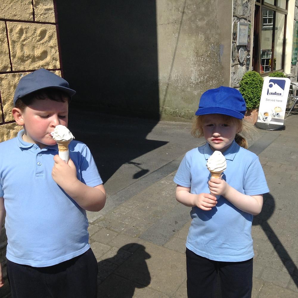 enjoying ice cream on way back from playground