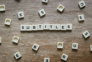 Subtitles alphabet square on wooden back