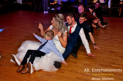 Guests at Wedding group dance to oops upside your head.