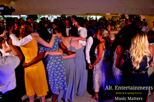 Guests dancing at Wedding Comberemere Abbey. DJ and Disco Services by Alt. Entertainments located in Walsall Wood near Lichfield & Sutton Coldfield.