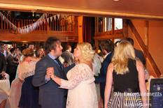 Bride, Groom & Guests dance at Wedding Reception