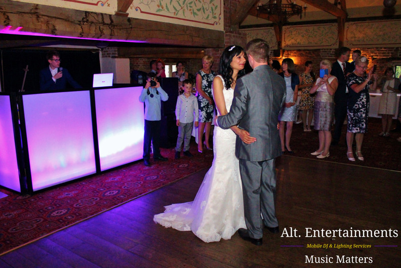 Bride and Groom First Dance in front of Wedding DJ