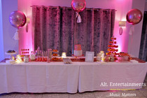 The Cake table Highlighted with subtle uplighting by Alt. Entertainments Mobile DJ, Disco & Lighting Solutions.