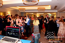 View from the DJ booth of a sophisticated wedding at Lodore Falls Hotel.