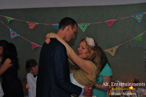 Bride and Groom Dance Their First Dance at Wedding