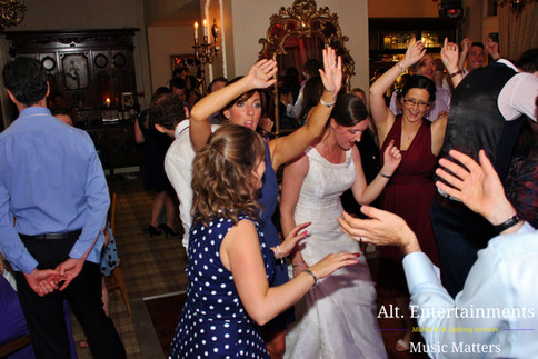 Bride with Friends Dancing at her wedding