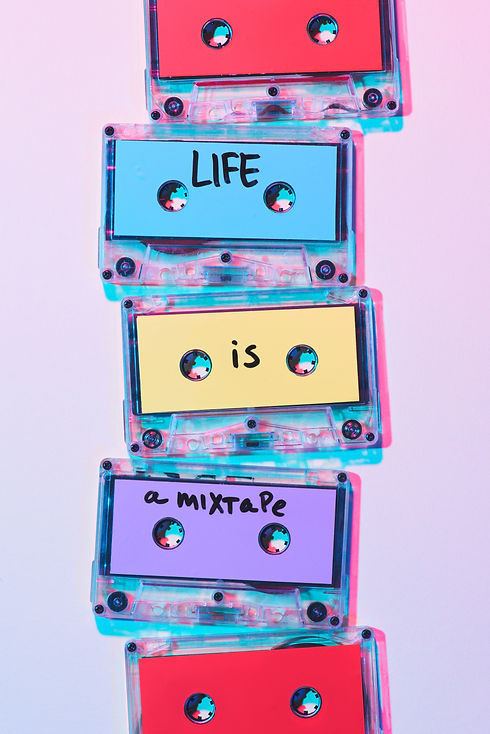 Three cassettes with a handwritten design saying 'life is a mixtape' between them.
