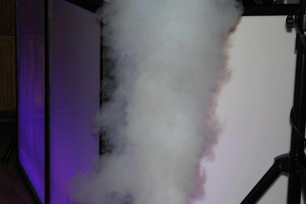 A Vertical Fog Machine bening used By Alt. Entertainments mobile DJ, Disco, Lighting & Events.