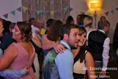 Geusts Dancinng on a Full Dance Floor