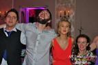 Having fun towards the end of a wedding.
