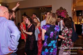 Wedding guests enjoying the disco.