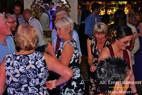 Multi generations enjoying dance floor at wedding.