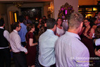 Friends and Family pack dance floor with bride.