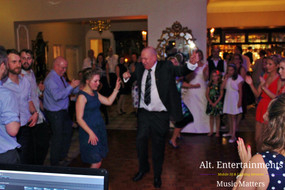 Multi generations of friends and family on dance floor