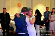 Bride and Groom first dance together on dance floor.