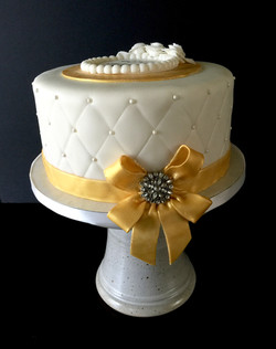 Quilted Cake with Gold Bow