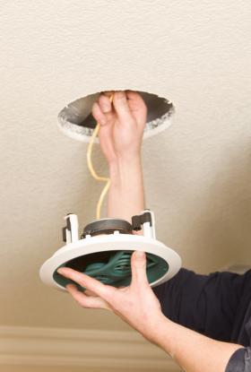 -Man-installing-ceiling-speakers-IS