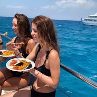 women eating paella on a boat.jpg