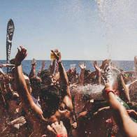 Champagne Spray on the Ibiza Boat Party at Cirque de la Nuit