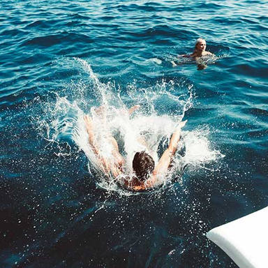 man jumping off boat with waterslide.jpg