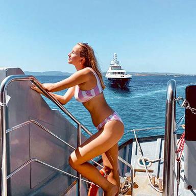 girl posing with yacht in ibiza.jpg