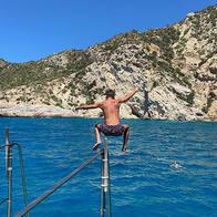 guy jumping in ibiza from boat.jpg
