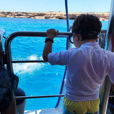 kid boy with snorkelling mask in ibiza.j