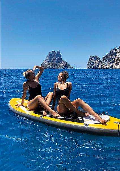 girls on a sup board with es vedra.jpg