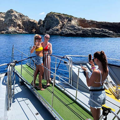 girls taking pictures on the ibiza boat