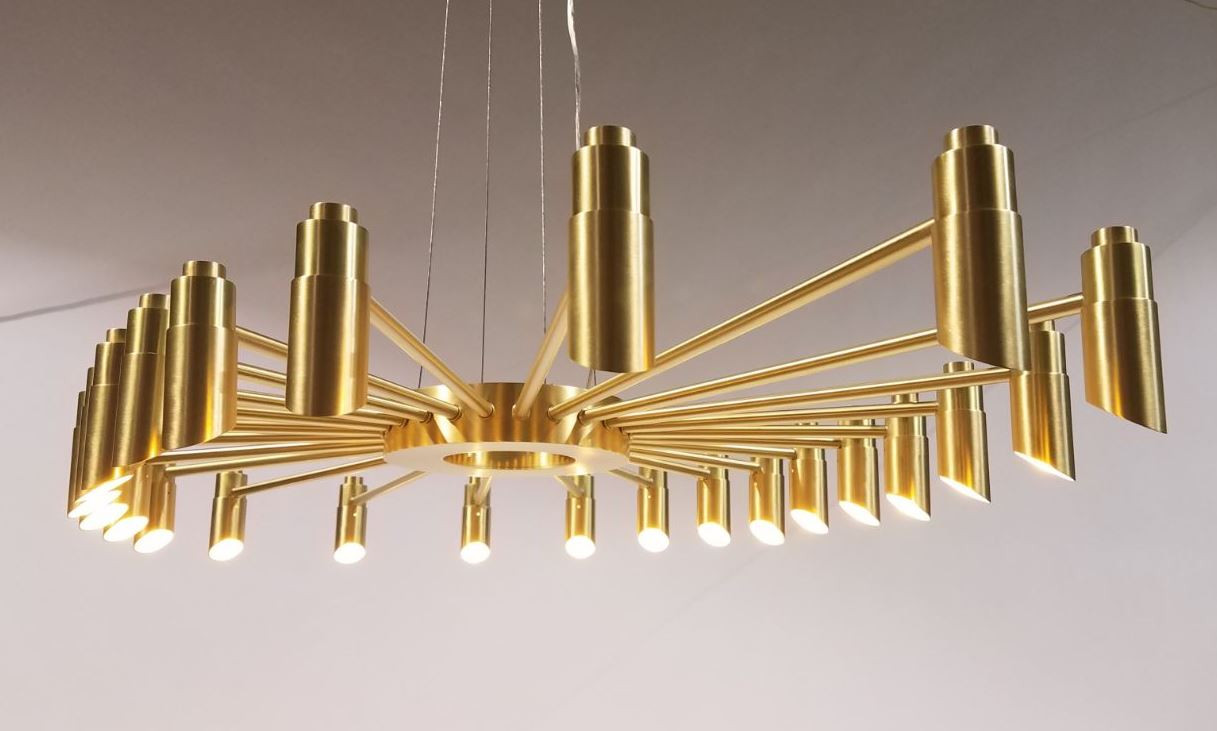 Ceiling Fixture custom handmade from solid brass. Suspended by cable. 24 Down lights in an oval shape.