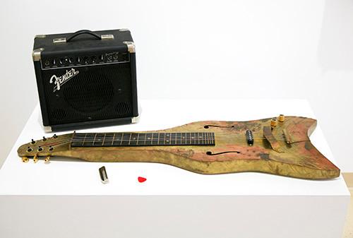 Esteban Bojorquez, The Manta, Electric lap steel guitar brass, 2003, 40 x 13 x 3 inches