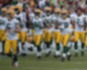 Packers running onto field.jpg