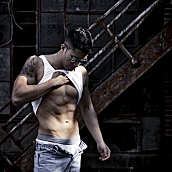 baltimore metro area photographer, Columbian Male amature bodybuilder in Baltimore City admiring abs cbdphotography