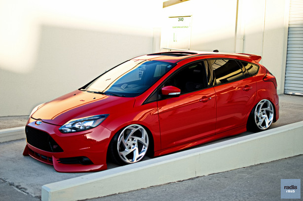 Lady in red with Brendan's 2013 Ford Focus ST