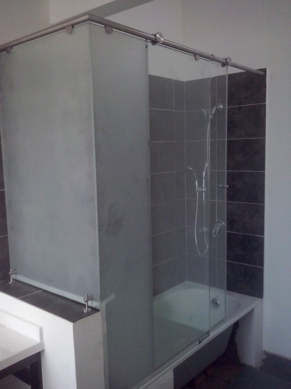 División de baño para tina