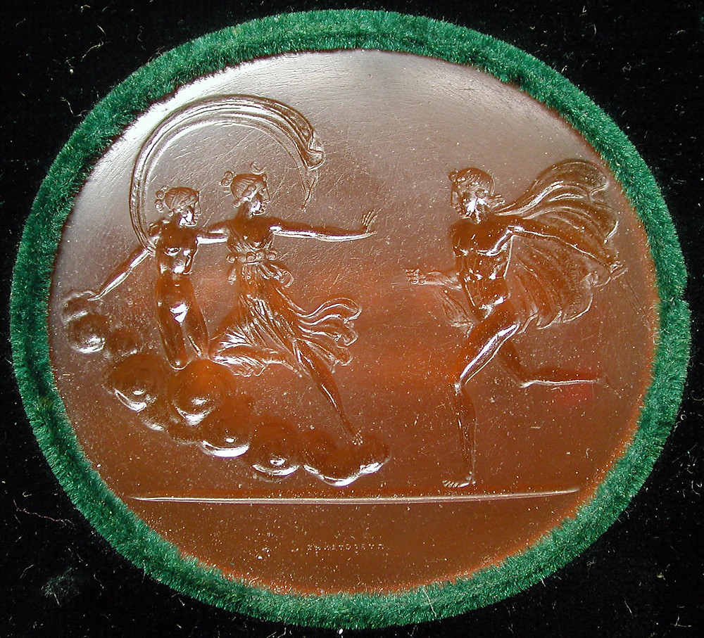 19th century gemstone carved with a scene from Greek mythology: Artemis protects Erigone from the wrath of her half-brother, Orestes.