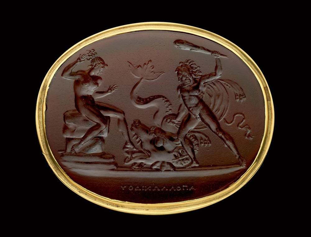 Carnelian gemstone from the 19th century engraved with a mythological scene of Herakles rescuing Hesione of Troy from a sea monster sent by the god Poseidon